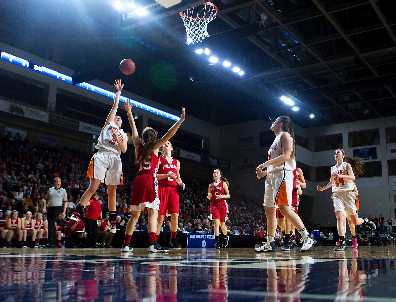 BANGOR, Maine -- 03/04/2017 -- Shead's Holly Preston (left) drives up for two past Vinalhaven's Deja Doughty during their Class D girls basketball state championship at the Cross Insurance Center in Bangor Saturday. Ashley L. Conti   BDN