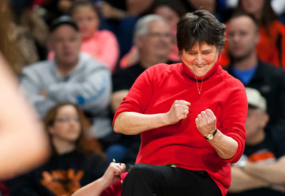 BANGOR, Maine -- 03/04/2017 -- Vinalhaven head coach Sandy Nelson celebrates after her team scored a point during their Class D girls basketball state championship against Shead at the Cross Insurance Center in Bangor Saturday. Ashley L. Conti | BDN