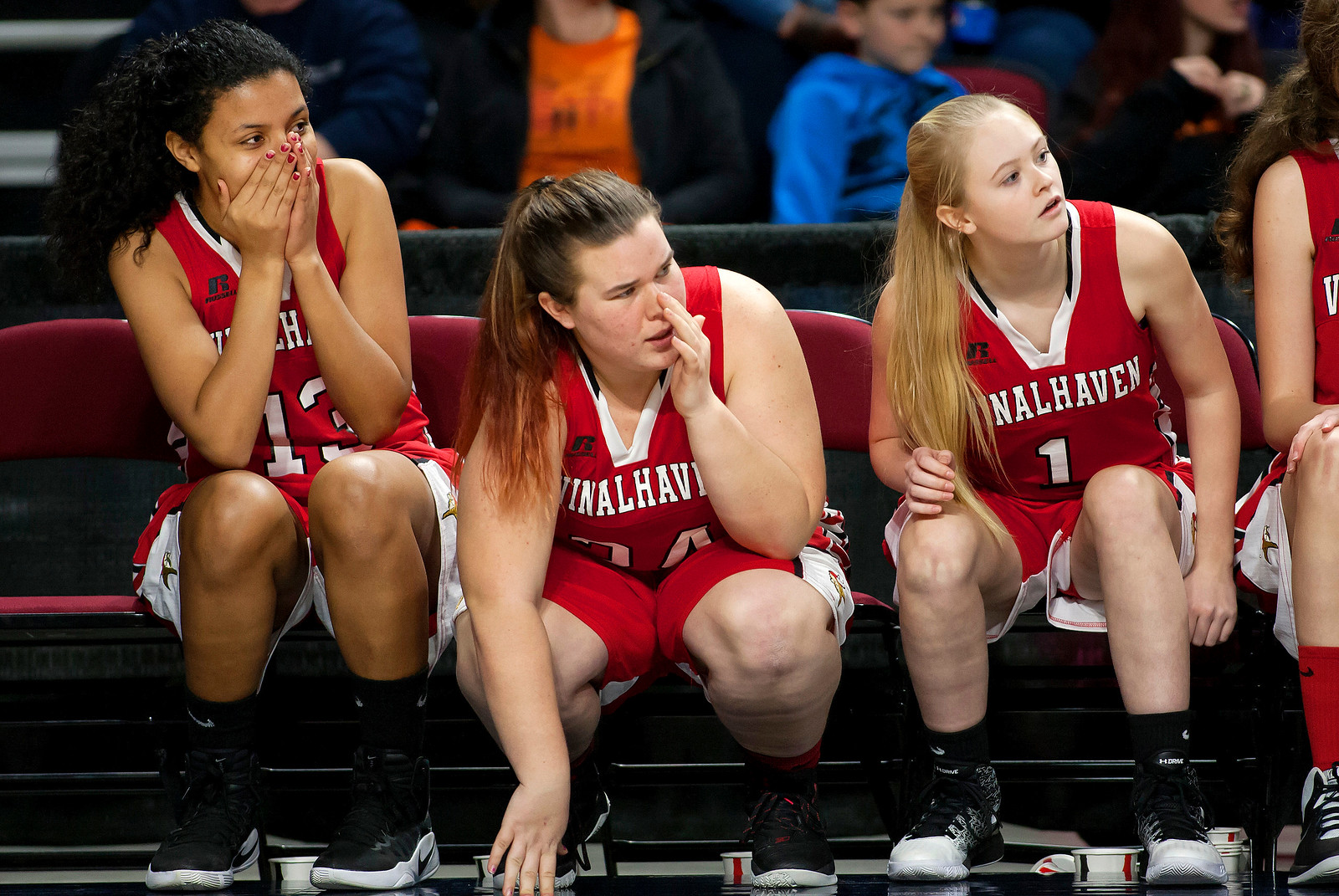 BANGOR, Maine -- 03/04/2017 -- Vinalhaven's Rosanna Morel (left) sits in disbelief as her team takes the win against Shead during their Class D girls basketball state championship at the Cross Insurance Center in Bangor Saturday. Ashley L. Conti | BDN