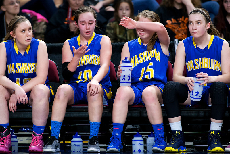BANGOR, Maine -- 02/23/2017 -- Washburn sits dejected as time winds down during their Class D girls basketball semifinal game against Shead at the Cross Insurance Center in Bangor Thursday. Ashley L. Conti | BDN