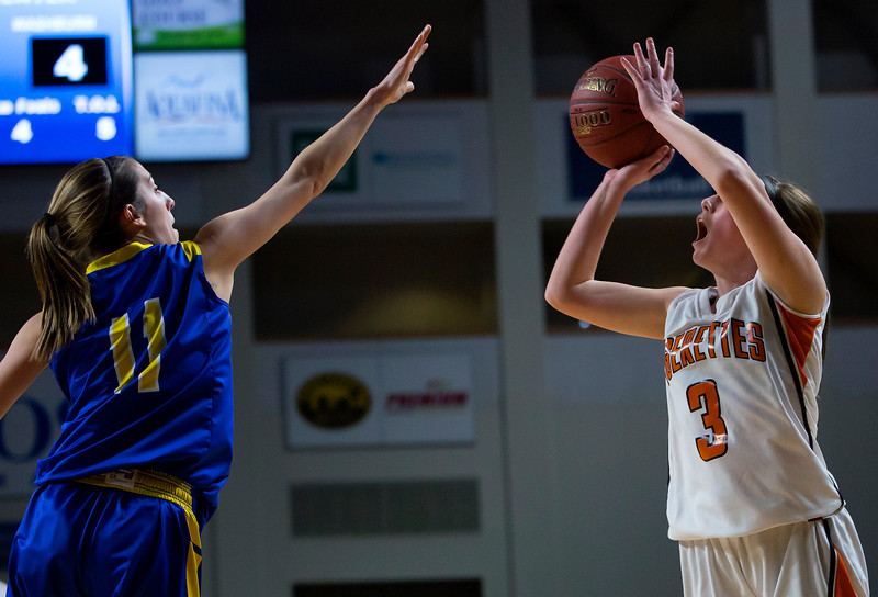 BANGOR, Maine -- 02/23/2017 -- Shead's Holly Preston (right) puts up a shot past Washburn's Kristen Sarmiento during their Class D girls basketball semifinal game at the Cross Insurance Center in Bangor Thursday. Ashley L. Conti | BDN