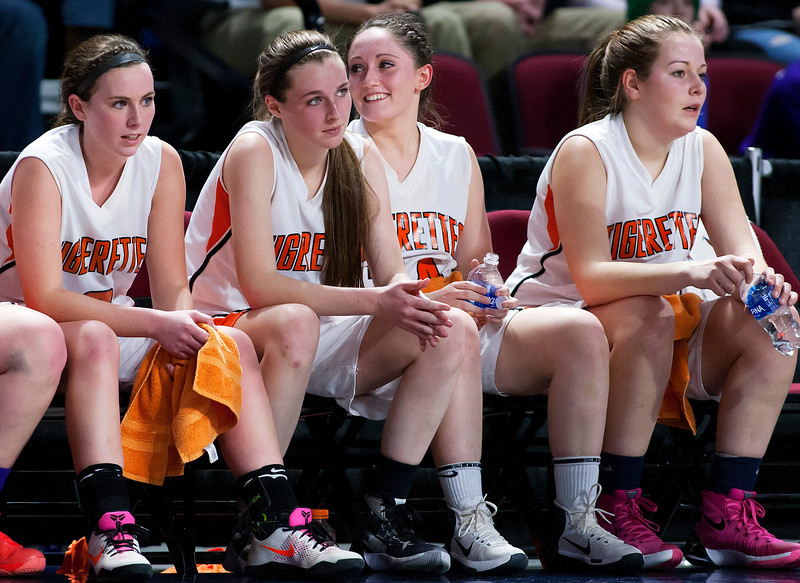 BANGOR, Maine -- 02/23/2017 -- Shead's Katelyn Mitchell (second from right) smiles as times runs out giving her team the win during their Class D girls basketball semifinal game against Washbur at the Cross Insurance Center in Bangor Thursday. Ashley L. Conti | BDN