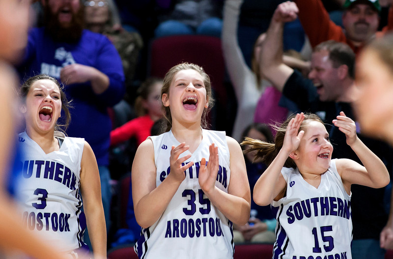 BANGOR, Maine -- 02/23/2017 -- Southern Arroostook's Aliyah Morales (from left), Danielle Libby, and Paige Vose cheer after their team scored to clinch the win against Easton during their Class D girls basketball semifinal game at the Cross Insurance Center in Bangor Thursday. Ashley L. Conti | BDN