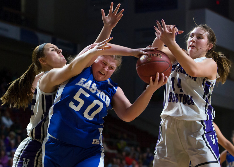 BANGOR, Maine -- 02/23/2017 --  Easton's Sara Gilman (center) battles for a rebound against Southern Arroostook's Sydney Brewer (left) and Southern Arroostook's Kacy Daggett during their Class D girls basketball semifinal game at the Cross Insurance Center in Bangor Thursday. Ashley L. Conti | BDN