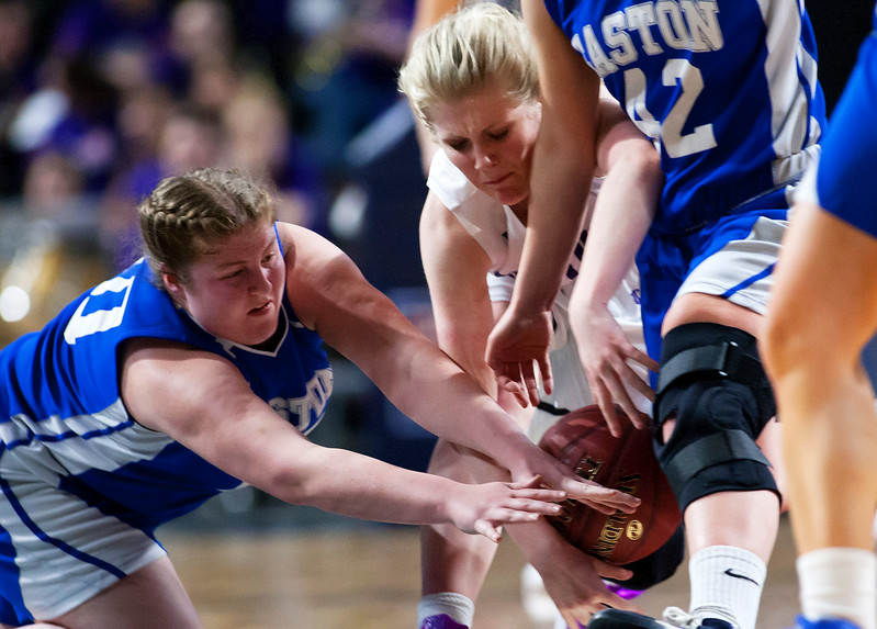 BANGOR, Maine -- 02/23/2017 -- Easton's Sara Gilman (left) and Southern Arroostook's Kassidy Mathers battle for a loose ball during their Class D girls basketball semifinal game at the Cross Insurance Center in Bangor Thursday. Ashley L. Conti | BDN