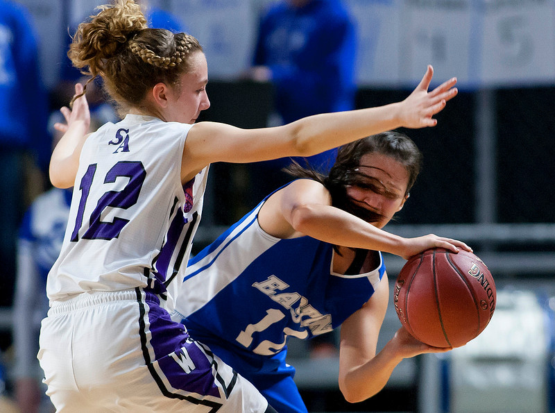 BANGOR, Maine -- 02/23/2017 -- Easton's Isabelle Morin (right) swings a pass around Southern Arroostook's Makaelyn Porter during their Class D girls basketball semifinal game at the Cross Insurance Center in Bangor Thursday. Ashley L. Conti | BDN