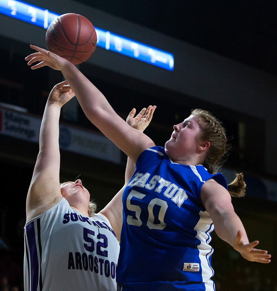 BANGOR, Maine -- 02/23/2017 -- Easton's Sara Gilman (right) blocks a shot from Southern Arroostook's Madison Cummings during their Class D girls basketball semifinal game at the Cross Insurance Center in Bangor Thursday. Ashley L. Conti | BDN
