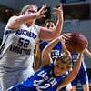 BANGOR, Maine -- 02/23/2017 -- Easton's Casey Lovely (right) falls to the ground battling a rebound against Southern Arroostook's Madison Cummings during their Class D girls basketball semifinal game at the Cross Insurance Center in Bangor Thursday. Ashley L. Conti | BDN
