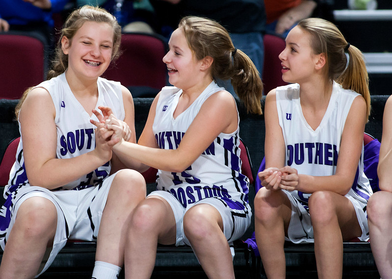 BANGOR, Maine -- 02/23/2017 -- Southern Arroostook's Danielle Libby (left) and Paige Vose celebrate as they realize their team will take the win against Easton during their Class D girls basketball semifinal game at the Cross Insurance Center in Bangor Thursday. Ashley L. Conti | BDN
