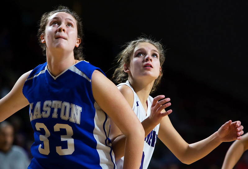 BANGOR, Maine -- 02/23/2017 -- Easton's Elise Allen (left) and Southern Arroostook's Kylie Vining wait to see if a rebound sinks during their Class D girls basketball semifinal game at the Cross Insurance Center in Bangor Thursday. Ashley L. Conti | BDN