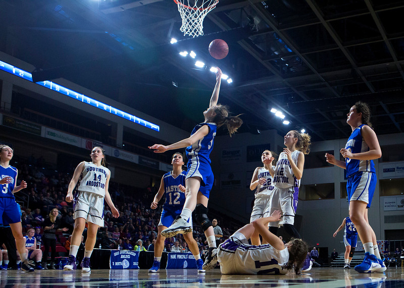 BANGOR, Maine -- 02/23/2017 -- Easton's Delaney Leach (center) is fouled by Southern Arroostook's Kylie Vining while trying for two during their Class D girls basketball semifinal game at the Cross Insurance Center in Bangor Thursday. Ashley L. Conti | BDN