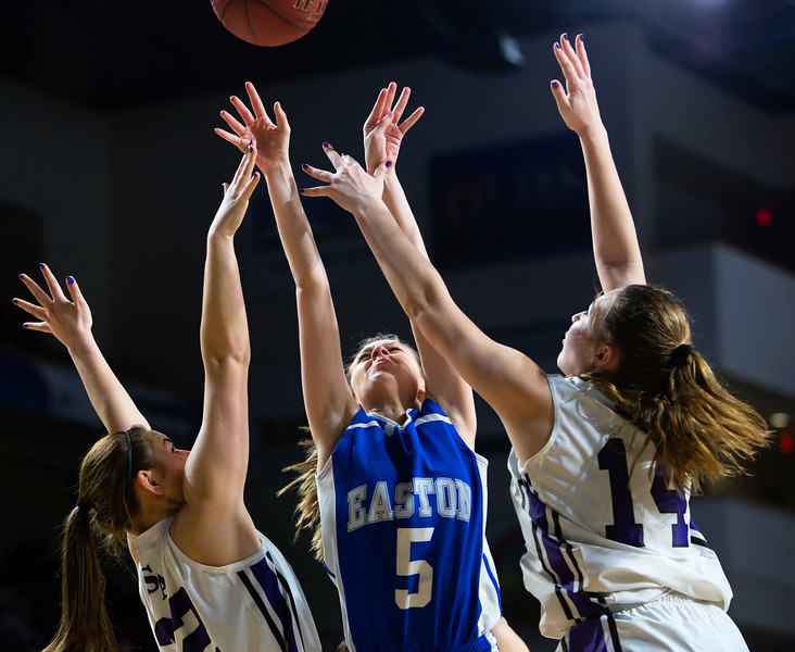 BANGOR, Maine -- 02/23/2017 -- Easton's Delaney Leach (center) goes up for two past Southern Arroostook's Sydney Brewer (left) and Southern Arroostook's Kacy Daggett during their Class D girls basketball semifinal game at the Cross Insurance Center in Bangor Thursday. Ashley L. Conti | BDN