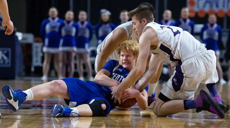 BANGOR, Maine -- 02/23/2017 -- Central Aroostook's Ben Thomas (left) battles for a rebound with Southern Arroostook's Jackson Mathers during their Class D boys basketball semifinal game at the Cross Insurance Center in Bangor Thursday. Ashley L. Conti | BDN