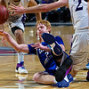 BANGOR, Maine -- 02/23/2017 -- Central Aroostook's Ben Thomas (left) gets a pass off from the floor around Southern Arroostook's Jackson Mathers during their Class D boys basketball semifinal game at the Cross Insurance Center in Bangor Thursday. Ashley L. Conti | BDN