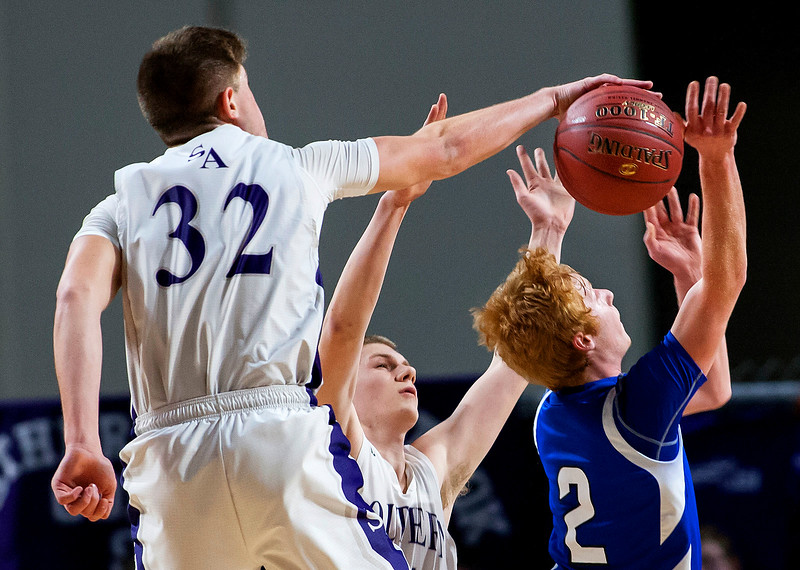 BANGOR, Maine -- 02/23/2017 -- Southern Arroostook's Nolan Altvater (left) blocks a shot from Central Aroostook's Ben Thomas during their Class D boys basketball semifinal game at the Cross Insurance Center in Bangor Thursday. Ashley L. Conti   BDN