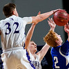 BANGOR, Maine -- 02/23/2017 -- Southern Arroostook's Nolan Altvater (left) blocks a shot from Central Aroostook's Ben Thomas during their Class D boys basketball semifinal game at the Cross Insurance Center in Bangor Thursday. Ashley L. Conti | BDN