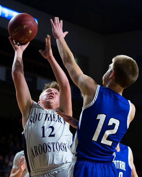 BANGOR, Maine -- 02/23/2017 -- Southern Arroostook's Tyler M. Batchedler (left) is fouled by Central Aroostook's Zach Crouch while trying for two during their Class D boys basketball semifinal game at the Cross Insurance Center in Bangor Thursday. Ashley L. Conti | BDN