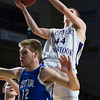 BANGOR, Maine -- 02/23/2017 -- Southern Arroostook's Jayden Burpee (right) flies in for two past Central Aroostook's Zach Crouch during their Class D boys basketball semifinal game at the Cross Insurance Center in Bangor Thursday. Ashley L. Conti | BDN