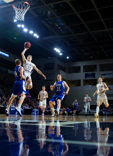 BANGOR, Maine -- 02/23/2017 -- Southern Arroostook's Jackson Mathers (second from left) flies in past Central Aroostook's Brayden Bradbury for two during their Class D boys basketball semifinal game at the Cross Insurance Center in Bangor Thursday. Ashley L. Conti   BDN