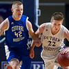 BANGOR, Maine -- 02/23/2017 -- Southern Arroostook's Jackson Mathers (right) drives down court past Central Aroostook's Gavin Miller during their Class D boys basketball semifinal game at the Cross Insurance Center in Bangor Thursday. Ashley L. Conti | BDN