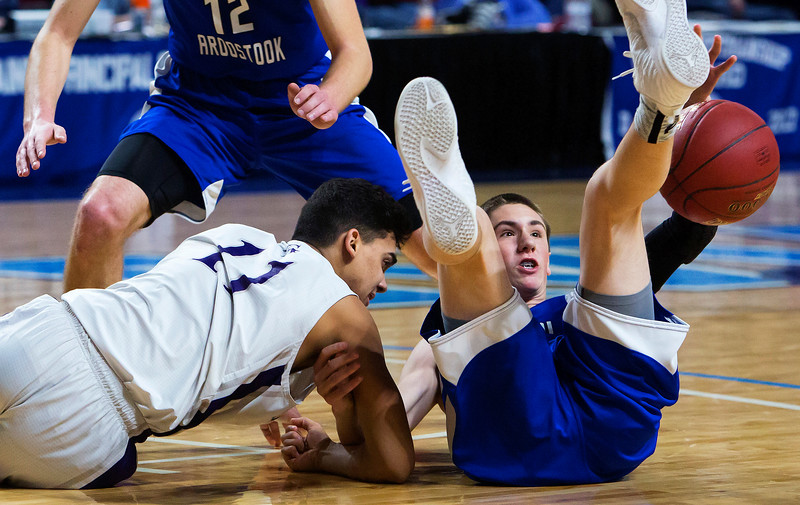 BANGOR, Maine -- 02/23/2017 -- Central Aroostook's Jacob Carvell (right) tries to regain control of a loose ball before Southern Arroostook's Luis Morales can during their Class D boys basketball semifinal game at the Cross Insurance Center in Bangor Thursday. Ashley L. Conti | BDN