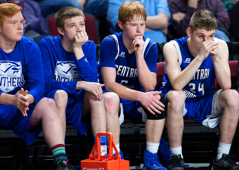 BANGOR, Maine -- 02/23/2017 -- Central Aroostook sits dejected as time expires during their Class D boys basketball semifinal game against Southern Arroostook at the Cross Insurance Center in Bangor Thursday. Ashley L. Conti   BDN
