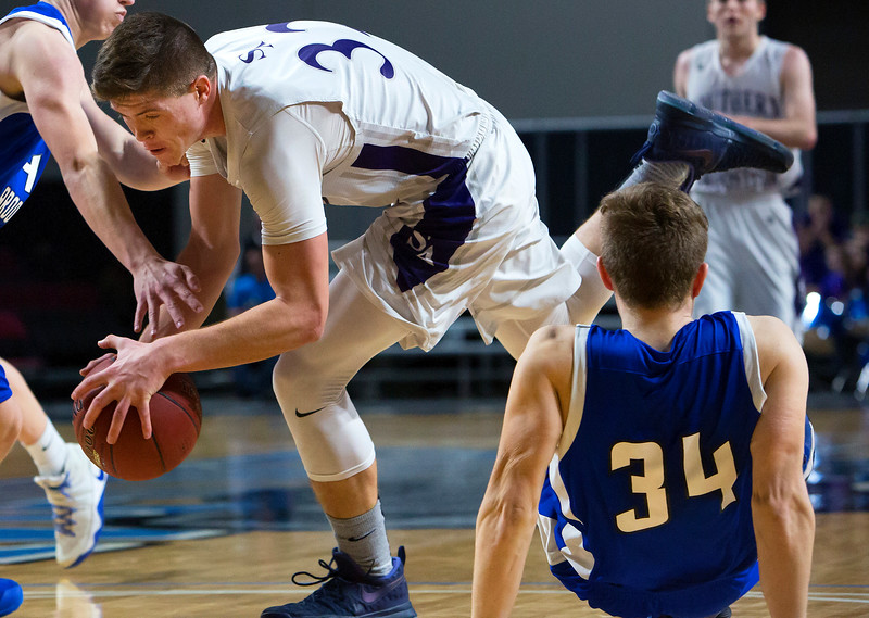 BANGOR, Maine -- 02/23/2017 -- Southern Arroostook's Nolan Altvater (left) is fouled by Central Aroostook's Colby Kingsbury during their Class D boys basketball semifinal game at the Cross Insurance Center in Bangor Thursday. Ashley L. Conti   BDN