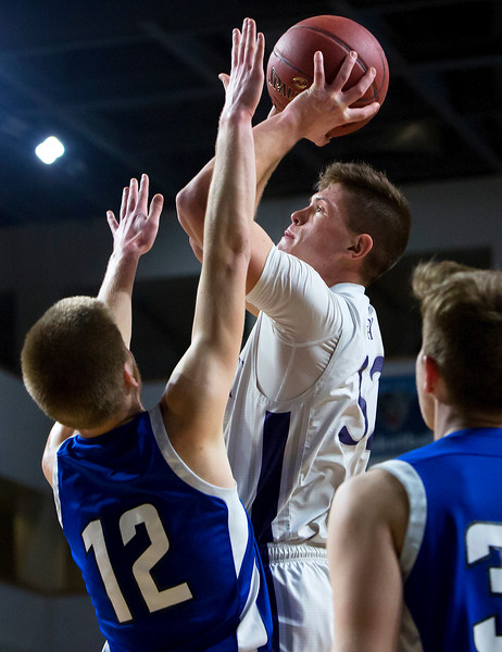 BANGOR, Maine -- 02/23/2017 -- Southern Arroostook's Nolan Altvater (right) puts up a shot past Central Aroostook's Zach Crouch during their Class D boys basketball semifinal game at the Cross Insurance Center in Bangor Thursday. Ashley L. Conti | BDN