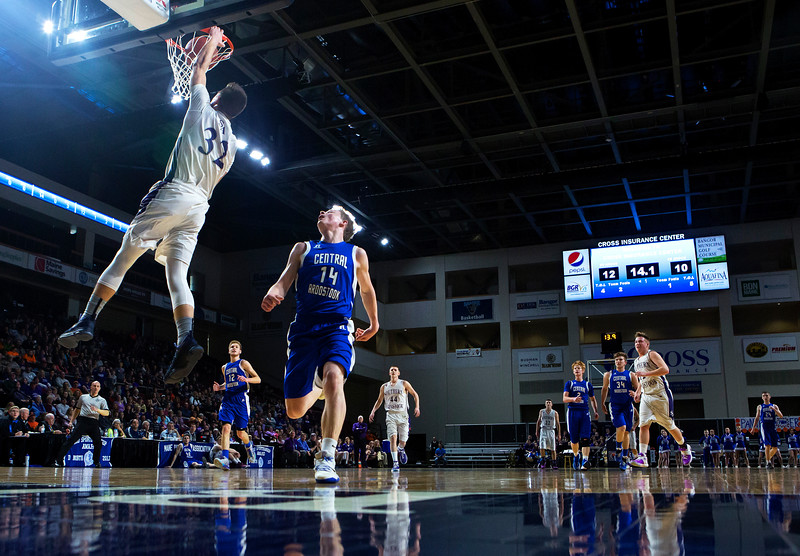 BANGOR, Maine -- 02/23/2017 -- Southern Arroostook's Nolan Altvater (left) slams a dunk past Central Aroostook's Brayden Bradbury during their Class D boys basketball semifinal game at the Cross Insurance Center in Bangor Thursday. Ashley L. Conti | BDN