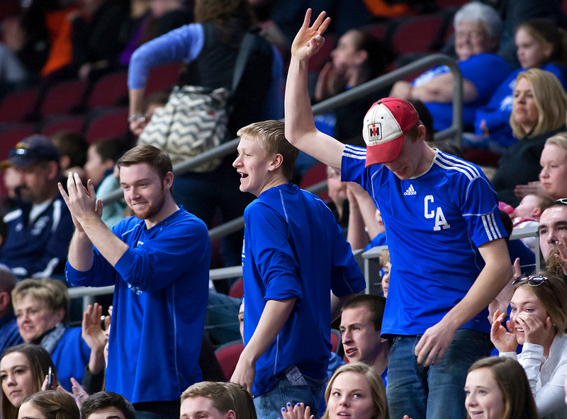 BANGOR, Maine -- 02/23/2017 -- Central Aroostook fans cheer after their team hit a three point shoot during their Class D boys basketball semifinal game against Southern Arroostook at the Cross Insurance Center in Bangor Thursday. Ashley L. Conti | BDN