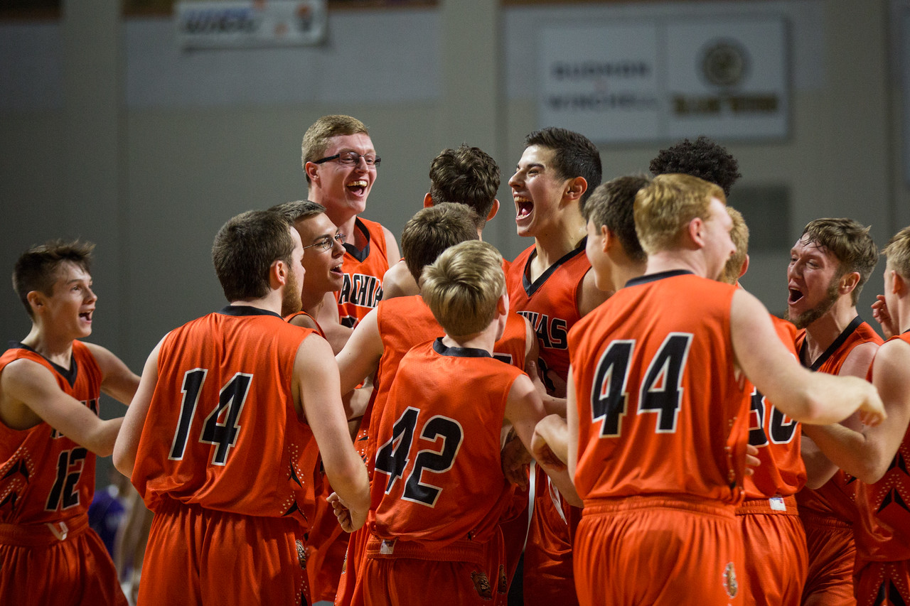 BANGOR, MAINE -- 02/25/2017 -- Machias High School's boys basketball team erupts in screams of joy, grouping together and jumping up and down following their class D boys basketball championship win against Southern Aroostook on Saturday morning at the Cross Insurance Center in Bangor. Micky Bedell   BDN