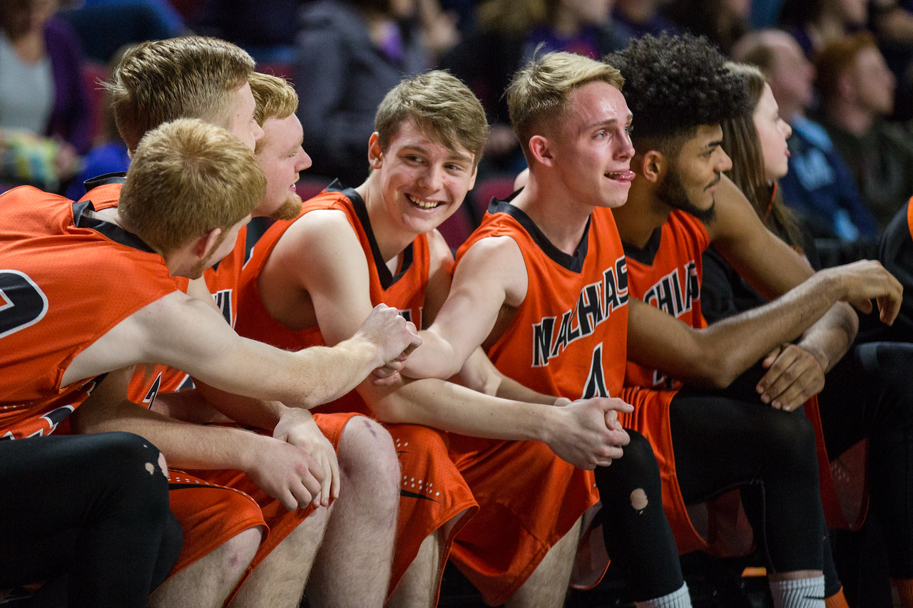 BANGOR, MAINE -- 02/25/2017 -- Machias' benched teammates grip each other as the clock runs down in the fourth quarter of their class D boys basketball championship game against Southern Aroostook on Saturday morning at the Cross Insurance Center in Bangor. Micky Bedell | BDN