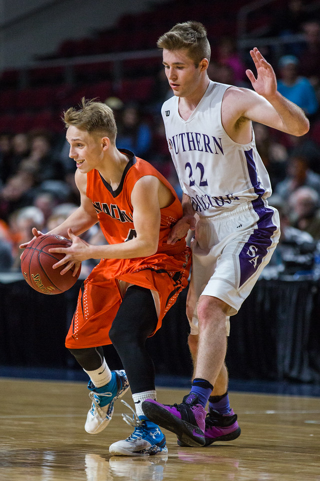 BANGOR, MAINE -- 02/25/2017 -- Machias' Russell Hanscom (left) tries to dribble past Southern Aroostook's Jackson Mathers during their class D boys final game at the Cross Insurance Center in Bangor on Saturday morning. Micky Bedell   BDN