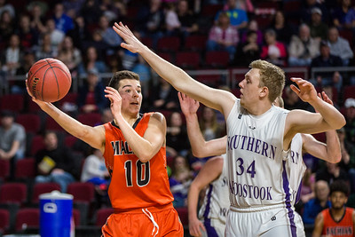 BANGOR, MAINE -- 02/25/2017 -- Machias' John Massaad (left) looks to pass as Southern Aroostook's Garrett Siltz tries to block during their class D boys final game at the Cross Insurance Center in Bangor on Saturday morning. Micky Bedell | BDN