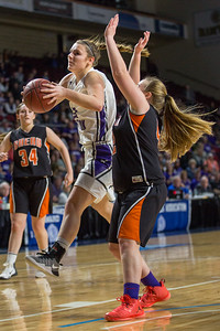 BANGOR, MAINE -- 0225/2017 -- Southern Aroostook's Kassidy Mathers (left) jumps to shoot as Shead's Halle Sullivan blocks during their class D girls championship game on Saturday morning at the Cross Insurance Center in Bangor. Micky Bedell | BDN