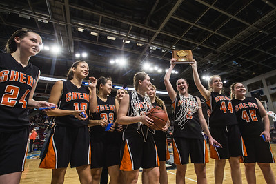 BANGOR, MAINE -- 02/25/2017 -- The Shead High Schools girls basketball team presents their team's championship plaque to cheering fans following their class D girls final basketball game against Southern Aroostook at the Cross Insurance Center in Bangor on Saturday morning. Micky Bedell | BDN