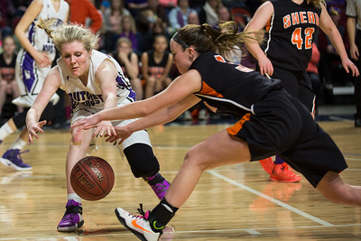 BANGOR, MAINE -- 02/25/2017 -- Southern Aroostook's Kassidy Mathers (left) and Shead's Holly Preston both dive for a loose ball during their class D girls championship game on Saturday morning at the Cross Insurance Center in Bangor. Micky Bedell | BDN