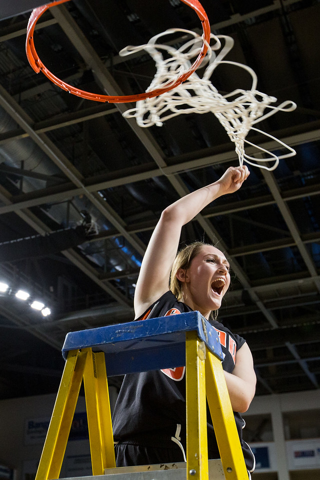 BANGOR, MAINE -- 02/25/2017 -- Shead High Schools girls basketball senior captain Katelyn Mitchell swings the net for cheering fans following their class D girls final basketball game against Southern Aroostook at the Cross Insurance Center in Bangor on Saturday morning. Micky Bedell | BDN