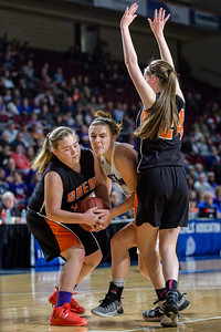 BANGOR, MAINE -- 0225/2017 -- Shead's Halle Sullivan (left) tries to grab the ball from Souther Aroostook's Sydney Brewer (center) and teammate Madison Greenlaw blocks a potential shot during their class D girls championship game on Saturday morning at the Cross Insurance Center in Bangor. Micky Bedell | BDN