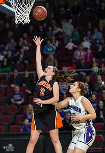 BANGOR, MAINE -- 02/25/2017 -- Shead's Holly Preston (left) takes a shot as Southern Aroostook's Sydney Brewer looks on during their class D girls championship game on Saturday morning at the Cross Insurance Center in Bangor. Micky Bedell | BDN