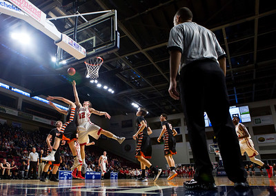 BANGOR, Maine -- 02/17/2017 -- Winslow's Michael Wildes (left) and Central's Caleb M. Shaw battle for a rebound during their Class B boys basketball quarterfinal game at the Cross Insurance Center in Bangor Friday. Ashley L. Conti   BDN