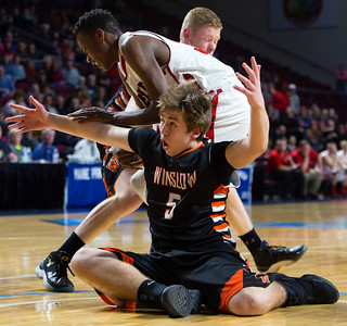 BANGOR, Maine -- 02/17/2017 -- Winslow's Hunter Campbell (right) looks to the referee for a call while fighting for a rebound with Central's Dylan B. Gray during their Class B boys basketball quarterfinal game at the Cross Insurance Center in Bangor Friday. Ashley L. Conti   BDN