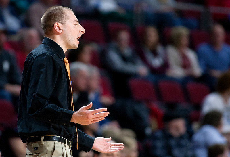 BANGOR, Maine -- 02/17/2017 -- Winslow head coach Jared Brown yells at a call to the referee during their Class B boys basketball quarterfinal game against Central at the Cross Insurance Center in Bangor Friday. Ashley L. Conti   BDN