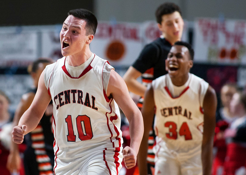 BANGOR, Maine -- 02/17/2017 -- Central's Andrew W. Speed (left) celebrates as his team pulls ahead of Winslow during their Class B boys basketball quarterfinal game at the Cross Insurance Center in Bangor Friday. Ashley L. Conti | BDN