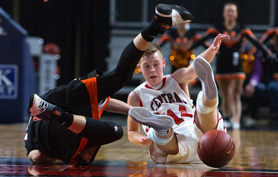 BANGOR, Maine -- 02/17/2017 -- Winslow's Dylan Hutchinson (left) and Central's Micah M. Ward battle on the floor for a loose ball during their Class B boys basketball quarterfinal game at the Cross Insurance Center in Bangor Friday. Ashley L. Conti   BDN