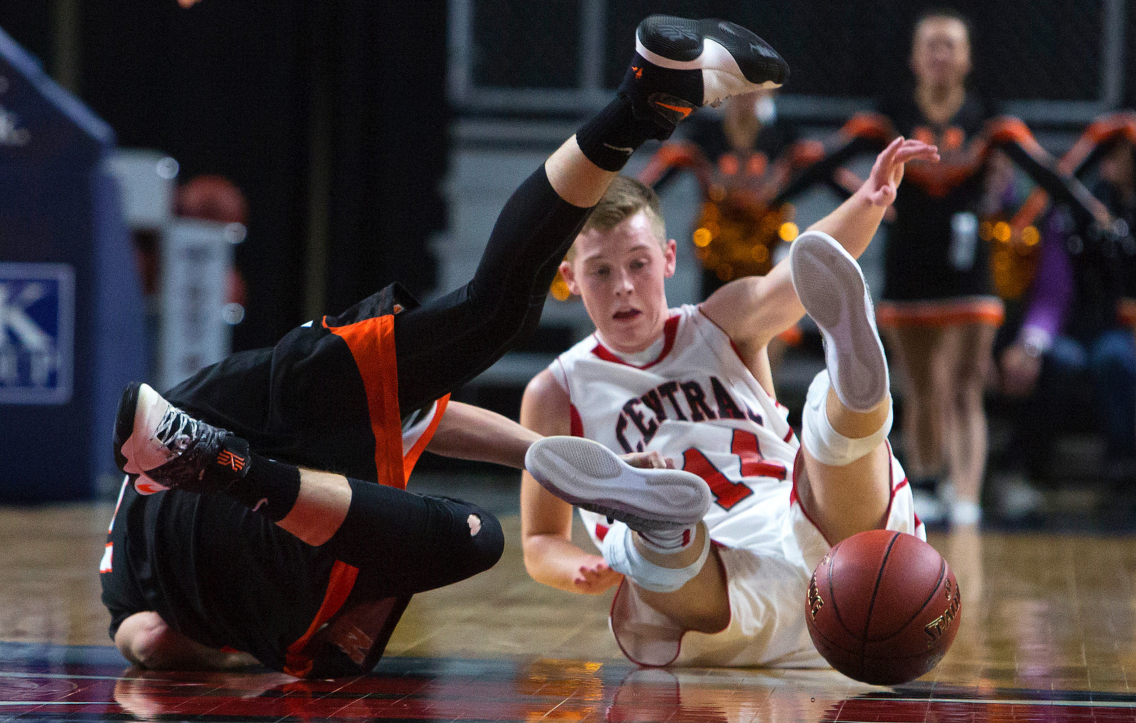 BANGOR, Maine -- 02/17/2017 -- Winslow's Dylan Hutchinson (left) and Central's Micah M. Ward battle on the floor for a loose ball during their Class B boys basketball quarterfinal game at the Cross Insurance Center in Bangor Friday. Ashley L. Conti | BDN