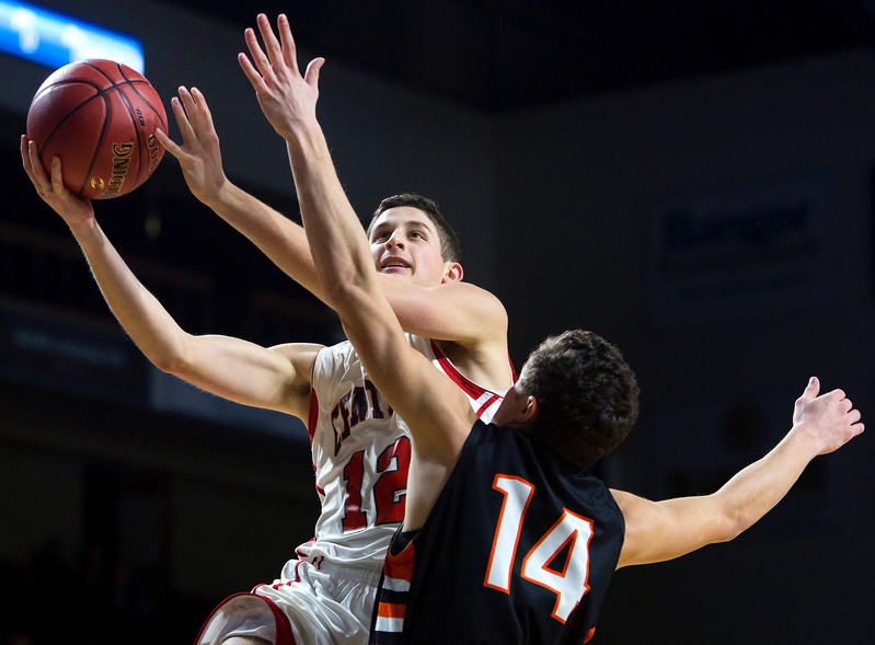 BANGOR, Maine -- 02/17/2017 -- Central's Caleb M. Shaw (left) drives up for two past Winslow's Dylan Hutchinson during their Class B boys basketball quarterfinal game at the Cross Insurance Center in Bangor Friday. Ashley L. Conti | BDN