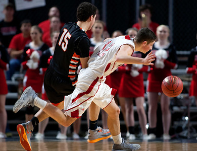 BANGOR, Maine -- 02/17/2017 -- Winslow's Jackson Morneault (left) trips up Central's Caleb M. Shaw during their Class B boys basketball quarterfinal game at the Cross Insurance Center in Bangor Friday. Ashley L. Conti   BDN
