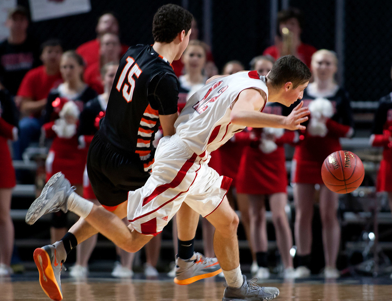 BANGOR, Maine -- 02/17/2017 -- Winslow's Jackson Morneault (left) trips up Central's Caleb M. Shaw during their Class B boys basketball quarterfinal game at the Cross Insurance Center in Bangor Friday. Ashley L. Conti | BDN
