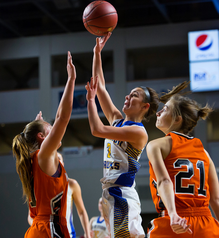 BANGOR, Maine -- 02/18/2017 -- Hermon's Alex Allain (center) puts up a shot past Winslow's Heather Kervin (left) and Winslow's Haley R. Ward during their Class B girls basketball quarterfinal game at the Cross Insurance Center in Bangor Saturday. Ashley L. Conti | BDN